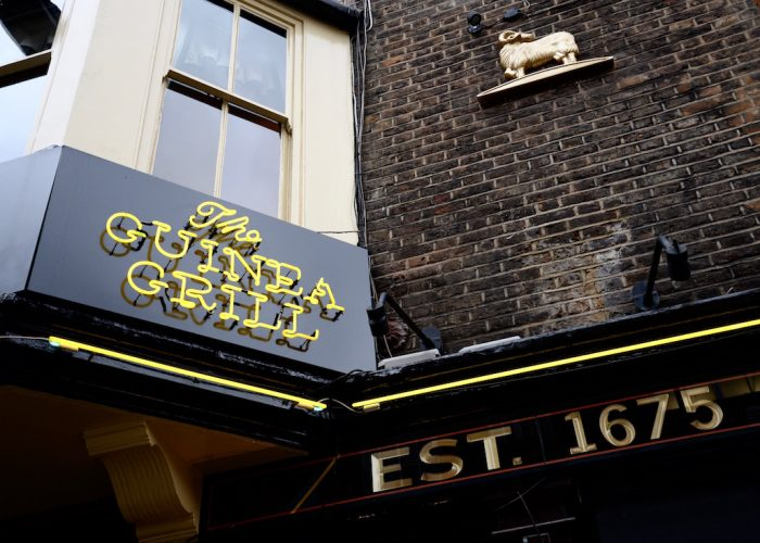Luxury private dining rooms at the guinea grill mayfair the guinea grill exterior image yellow neon sign publicscrutiny Image collections