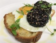 Bocconcino Restaurant Breakfast Food Image Fried Bread With Black Pudding Fried Egg Herb Garnish