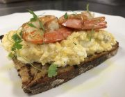 Bocconcino Restaurant Breakfast Food Image Scrambled Egg On Toast With Fresh Prawn Coriander Garnish