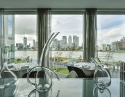 Peninsula Views of Canary Wharf With Decanters In Foreground.