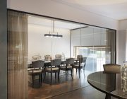 The Athenaeum Hotel Residences Private Dining Room Image Glass Panels Curtains In Foreground.