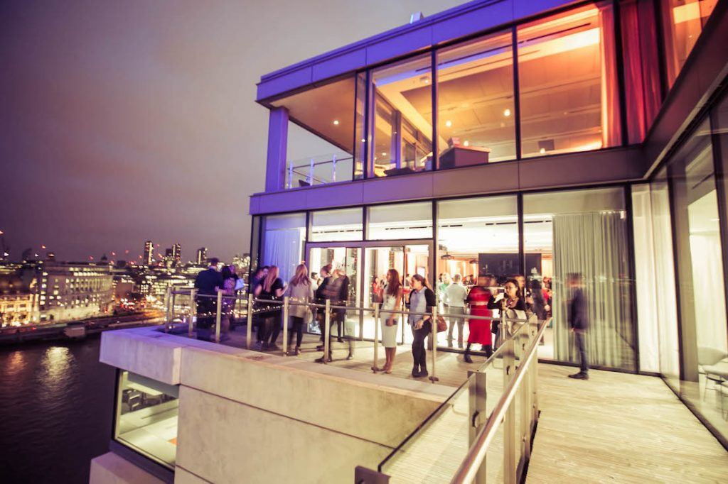 Sea Containers Events Guests On Terrace At Night With River Thames In Background