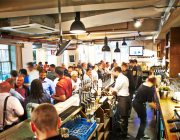 The Parcel Yard Pub Image With Guests Standing At Bar