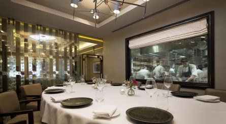 Murano By Angela Hartnett Private Dining Room Image View Of Chefs In Kitchen Through Glass Window 1 445x245