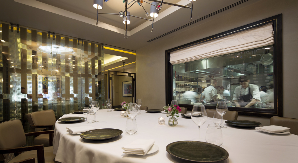 Murano By Angela Hartnett Private Dining Room Image View Of Chefs In Kitchen Through Glass Window 1 1043x570